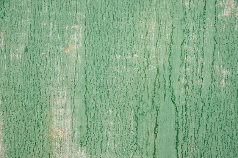 aded from time and weather painted in a light pastel green metal surface with cracks, streaks and rust. Background, structure royalty free stock image