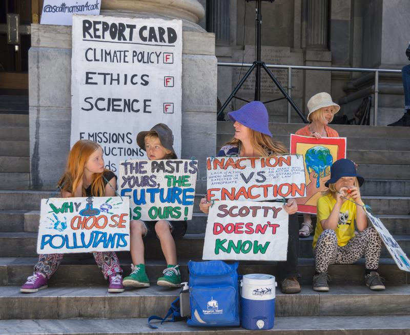 Heated Dialogue. Adelaide, AU - November 30, 2018: Hundreds of students in Adelaide gather outside of Parliament House demanding action on climate change stock images