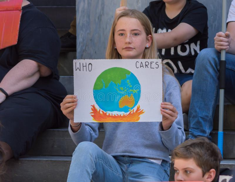Heated Dialogue. Adelaide, AU - November 30, 2018: Hundreds of students in Adelaide gather outside of Parliament House demanding action on climate change royalty free stock image