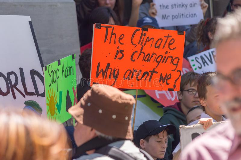Heated Dialogue. Adelaide, AU - November 30, 2018: Hundreds of students in Adelaide gather outside of Parliament House demanding action on climate change royalty free stock images