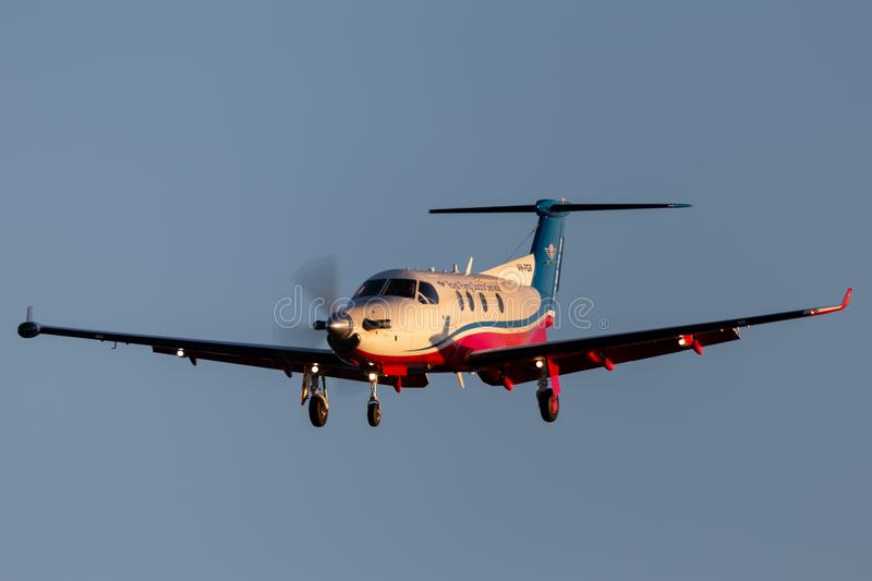 Royal Flying Doctors Service of Australia Pilatus PC-12 single engine air ambulance aircraft on approach to land at Adelaide Airpo stock images