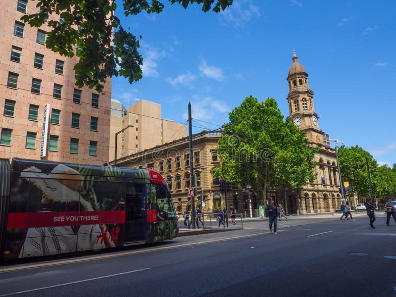 Red Light rail running through King William Street near Town Hall. ADELAIDE, SOUTH AUSTRALIA. - On November 06, 2018. – Red Light rail running through royalty free stock images