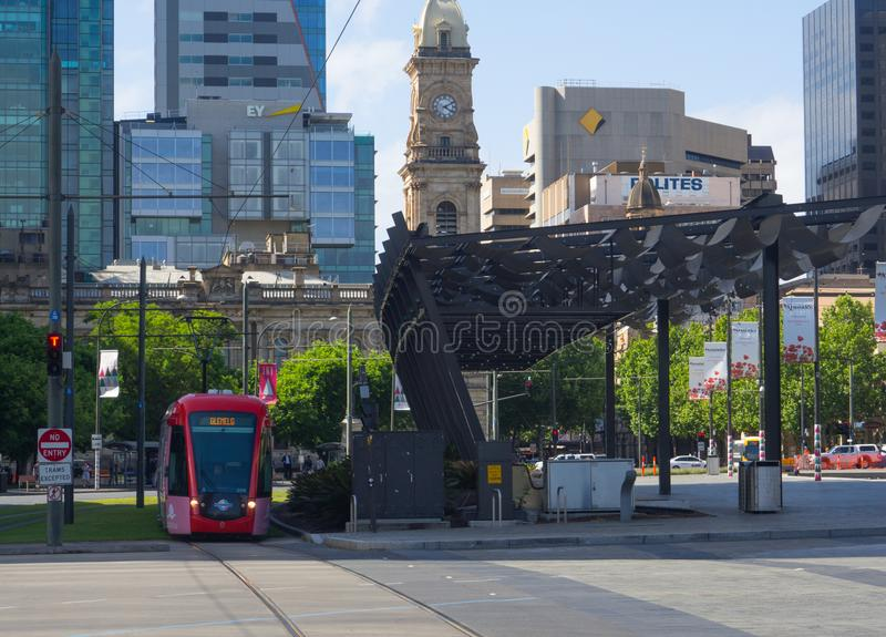 Red Light rail train stopping at Victoria square railway station. ADELAIDE, SOUTH AUSTRALIA. - On November 06, 2018. – Red Light rail train stopping at royalty free stock photo