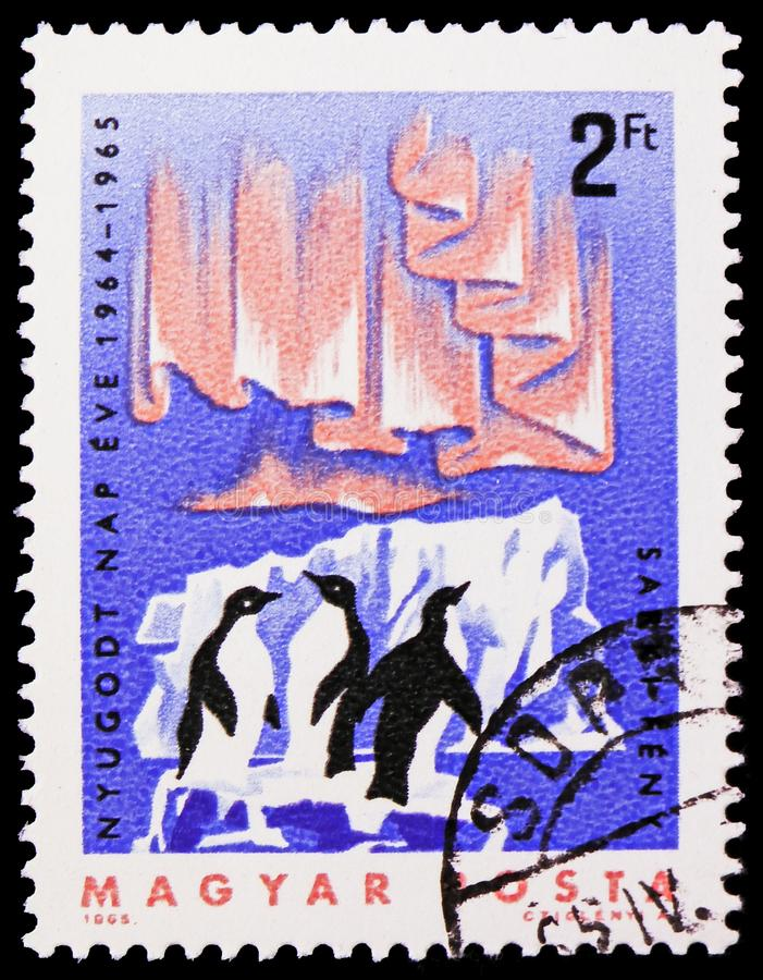 Adelie Penguin Pygoscelis adeliae, Aurora Borealis, International Quiet Sun Years serie, circa 1965. MOSCOW, RUSSIA - FEBRUARY 21, 2019: A stamp printed in royalty free stock images
