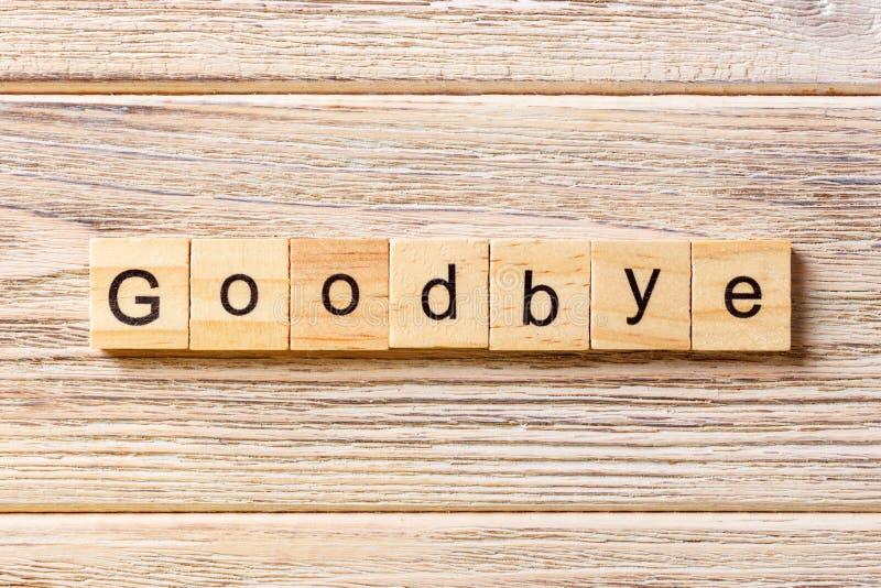 Adeus palavra escrita no bloco de madeira Adeus texto na tabela, conceito fotografia de stock