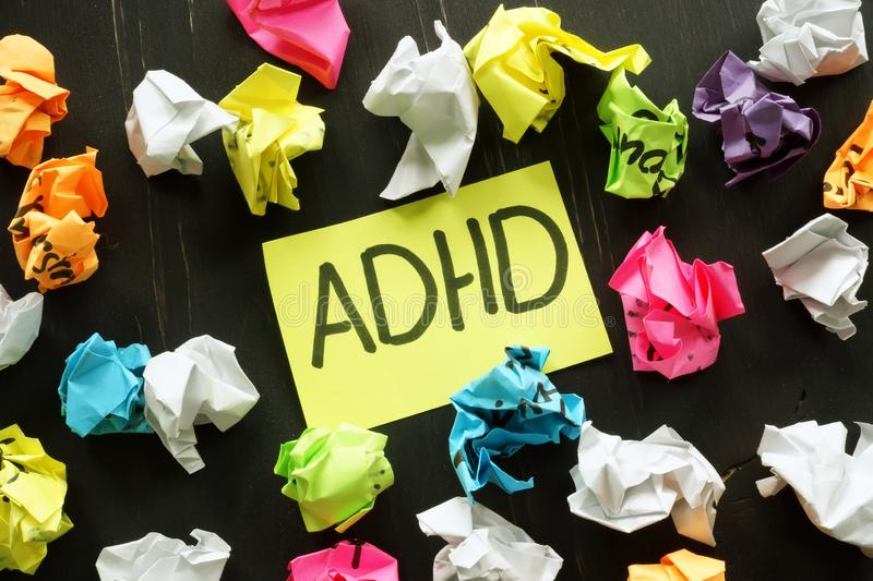 ADHD Attention deficit hyperactivity disorder sign. And paper balls stock image