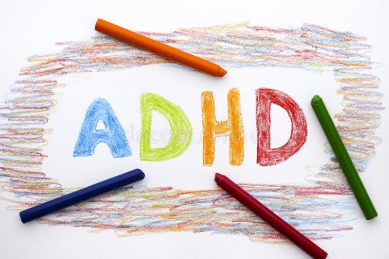 ADHD escrito en la hoja de papel fotos de archivo libres de regalías