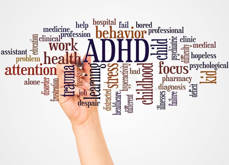 ADHD słowa ręka z markiera pojęciem i chmura fotografia stock