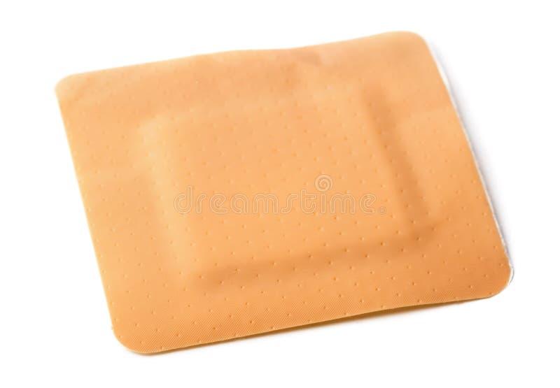 Adhesive bandage. Square adhesive bandage isolated on white royalty free stock images