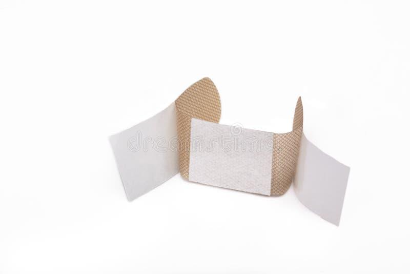 Adhesive bandage. Isolated Skin toned adhesive bandage royalty free stock photography