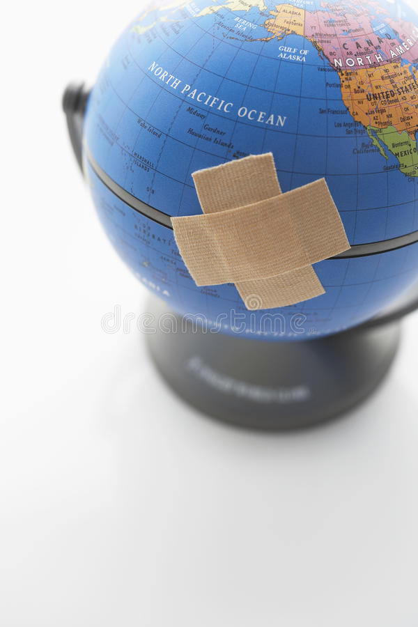 Adhesive Bandage On Globe. Signifying a heal or recycle theme royalty free stock photos