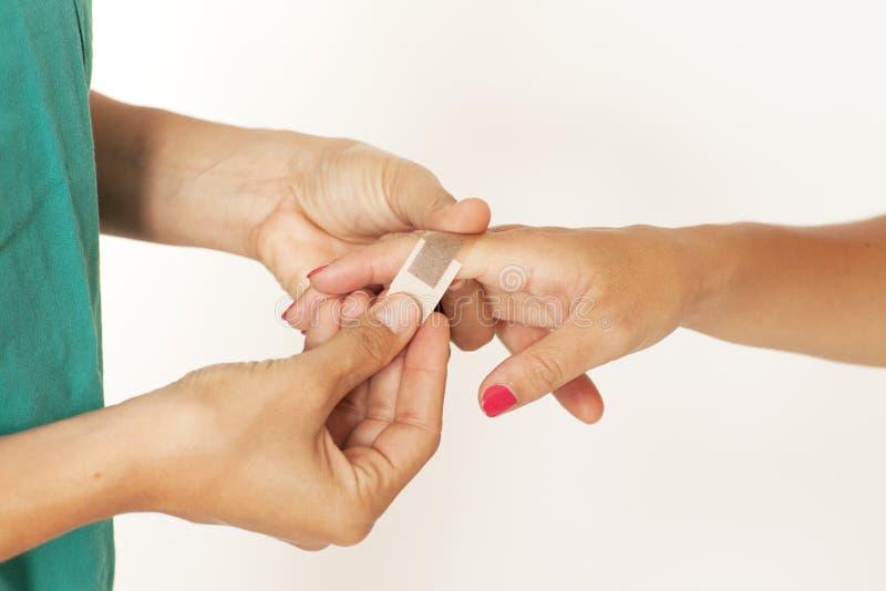 Adhesive bandage on hand stock photography