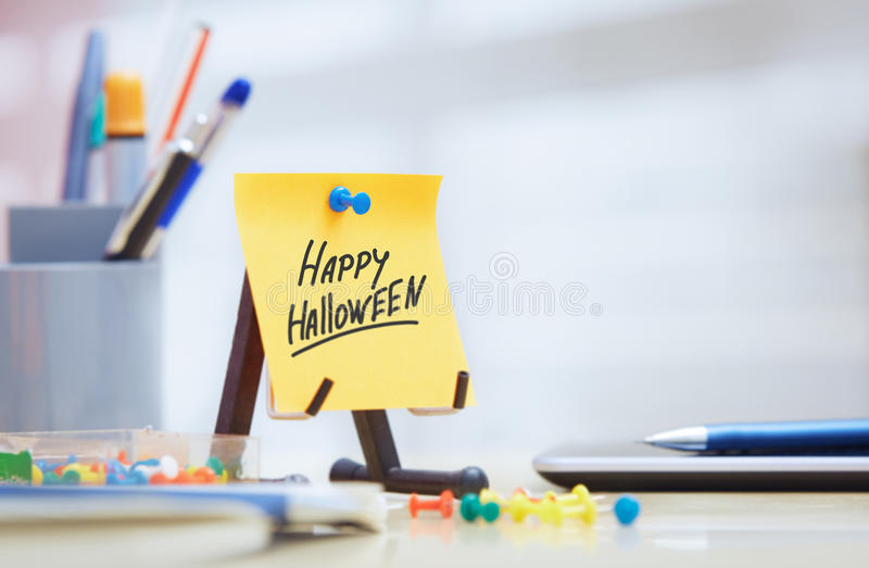 Adhesive note with Happy Halloween text royalty free stock images