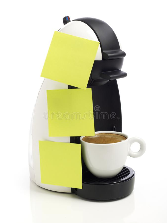 Adhesive notes on coffee maker royalty free stock image