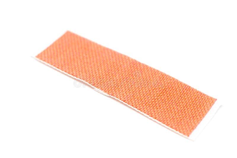 Adhesive sticking bandage plaster on isolated white background royalty free stock photos