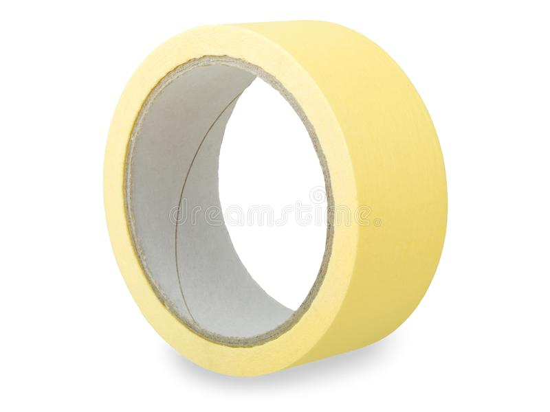 Adhesive tape. Roll of yellow adhesive tape isolated on white background royalty free stock image