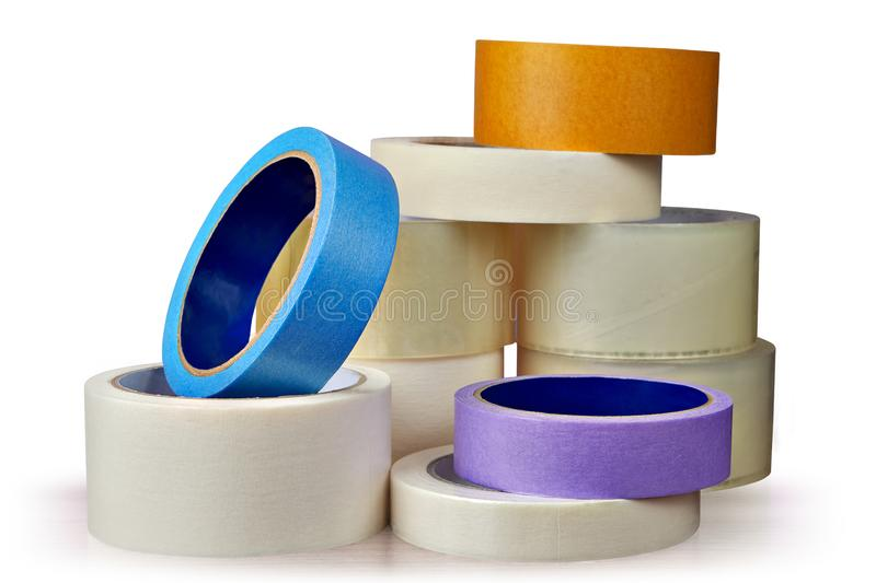 Adhesive tape in assortment, white background. stock image