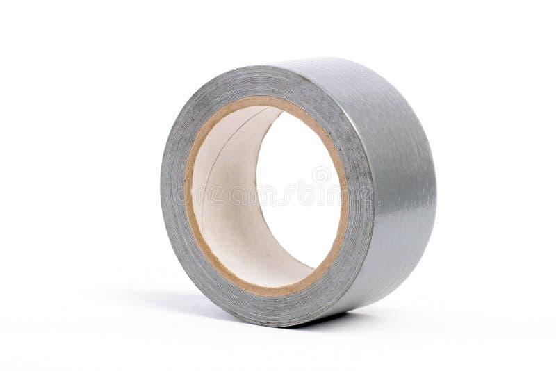 Adhesive tape grey. On the isolated white background stock image