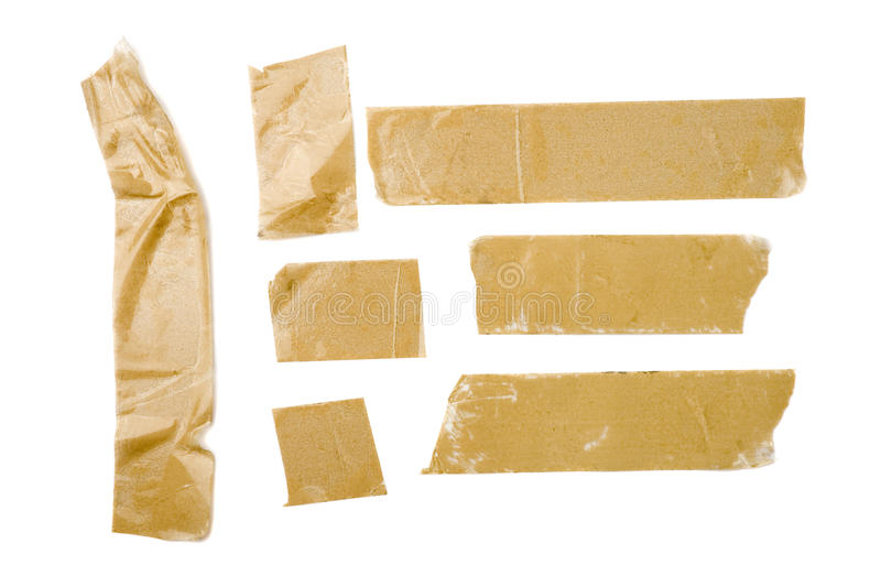 Adhesive Tape Strips. Strips of brown adhesive packaging tape isolated on white background stock photography