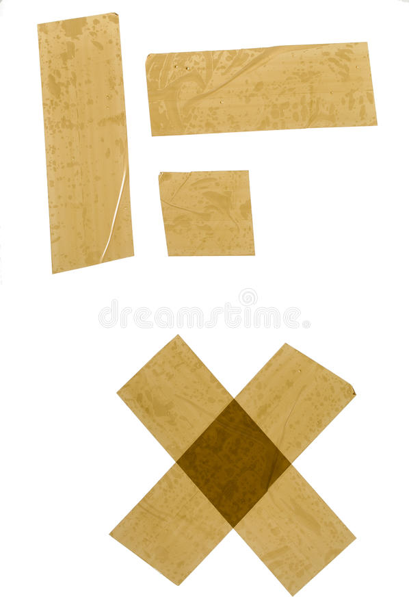 Adhesive Tape Strips. Strips of brown adhesive packaging tape isolated on white background royalty free stock photography