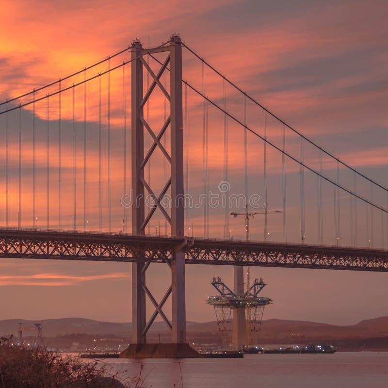 Adiante ponte da estrada no por do sol fotos de stock royalty free