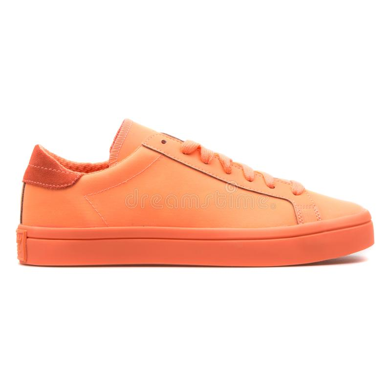 Adidas Courtvantage Adicolor orange sneaker. VIENNA, AUSTRIA - AUGUST 10, 2017: Adidas Courtvantage Adicolor orange sneaker on white background stock images