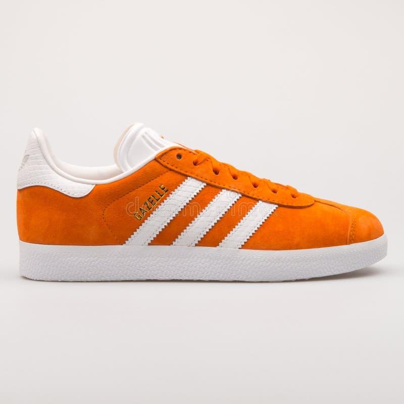 Adidas Gazelle orange and white sneaker. VIENNA, AUSTRIA - AUGUST 23, 2017: Adidas Gazelle orange and white sneaker on white background stock image