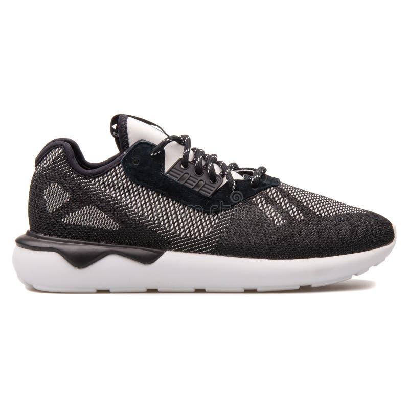 Adidas-Röhrenläufer Schwarzweiss-Turnschuh spinnen stockbild