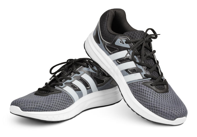 Adidas running shoes, sneakers or trainers isolated on white royalty free stock images