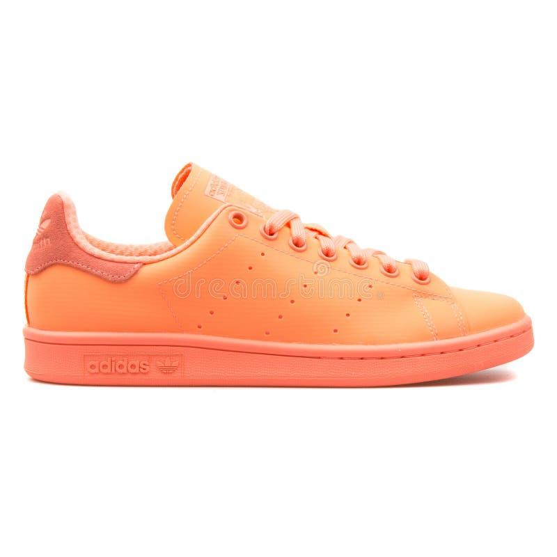Adidas Stan Smith Adicolor orange sneaker. VIENNA, AUSTRIA - AUGUST 10, 2017: Adidas Stan Smith Adicolor orange sneaker on white background stock photos