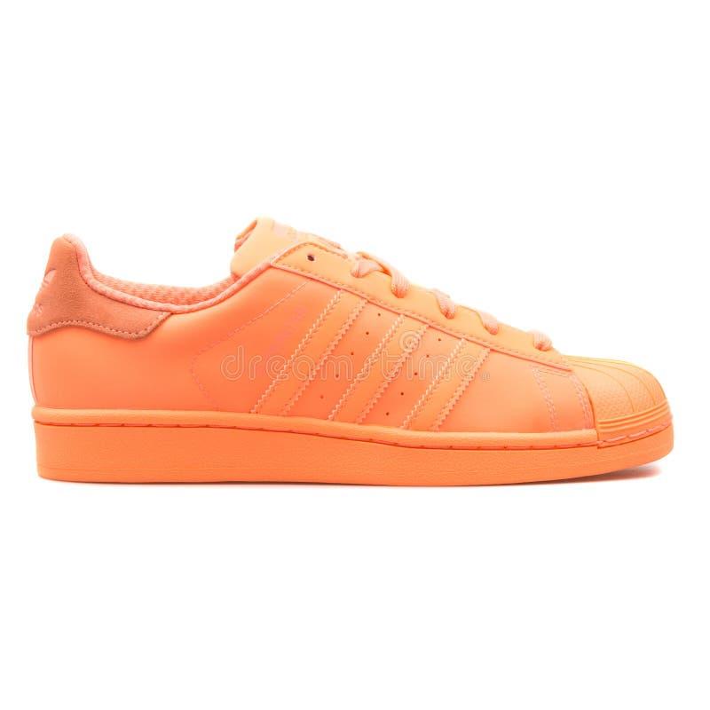 Adidas Superstar Adicolor orange sneaker. VIENNA, AUSTRIA - AUGUST 10, 2017: Adidas Superstar Adicolor orange sneaker on white background royalty free stock image