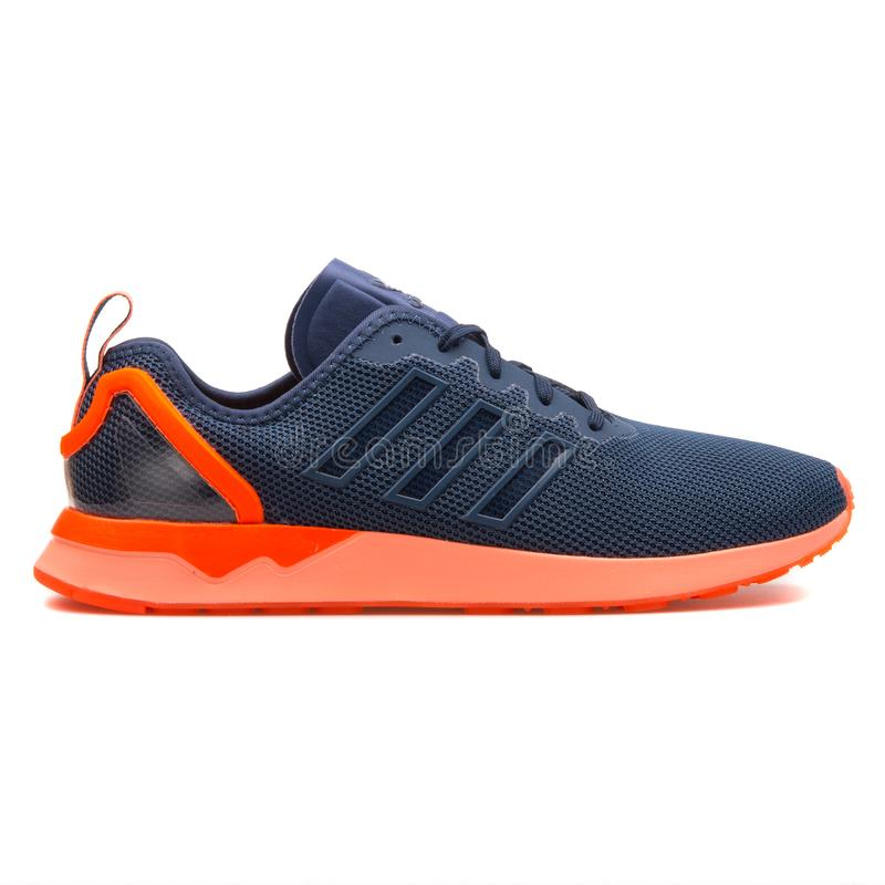 Adidas ZX Flux ADV blue and orange sneaker. VIENNA, AUSTRIA - AUGUST 10, 2017: Adidas ZX Flux ADV blue and orange sneaker on white background royalty free stock photos