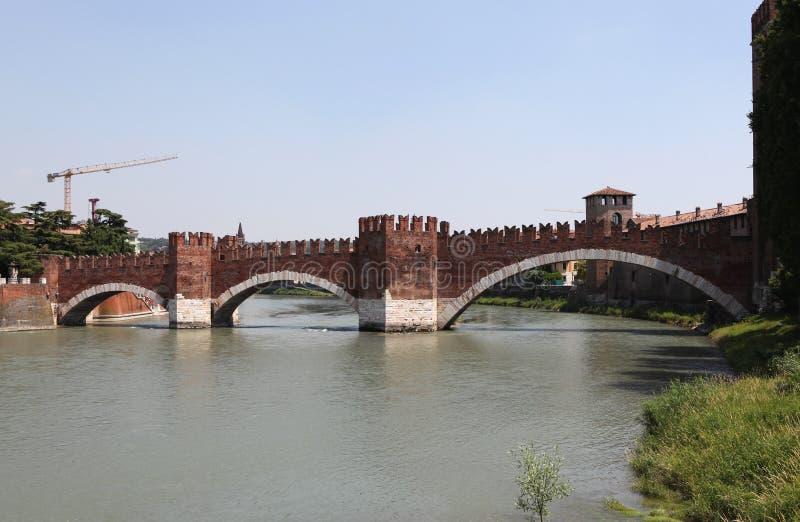 Adige river and the bridge Scaligero. Verona. Italy. Scaligero bridge - a bridge in Verona over the river Adige. Built in 1355 on the orders of Kangrande II royalty free stock photo
