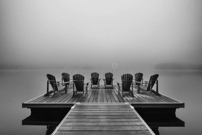 Adirondack deck chairs on lake dock. In Parc National du Mont-Tremblant royalty free stock photo