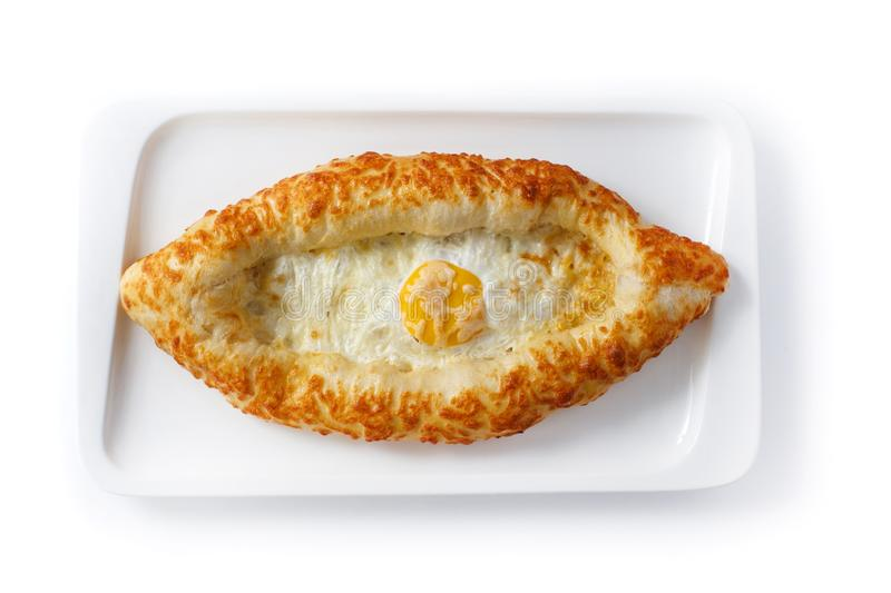 Adjar khachapuri in a white plate on an isolated white background stock photography