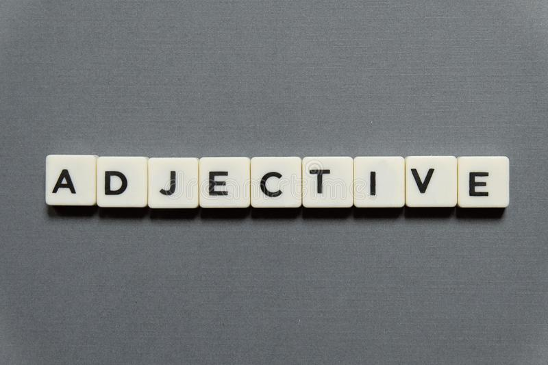 Adjective Word Made Of Square Letter Word On Grey Background ...