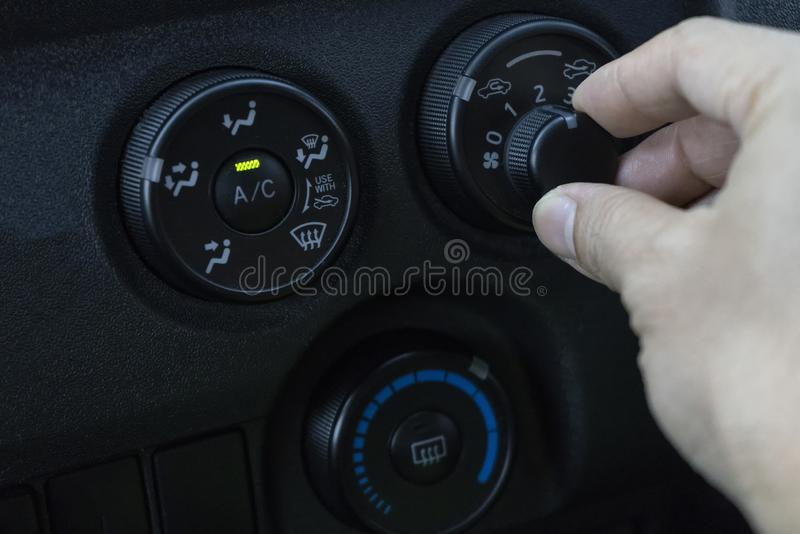 Adjust the air conditioner in the car.  stock images