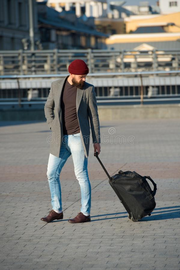 Adjust living in new city. Traveler with suitcase arrive airport railway station urban background. Hipster ready enjoy royalty free stock photography