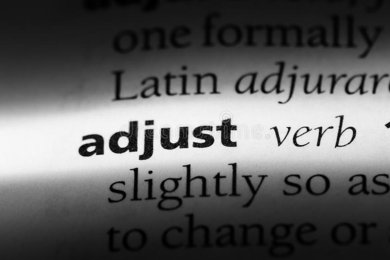 Adjust. Word in a dictionary.  concept royalty free stock photos