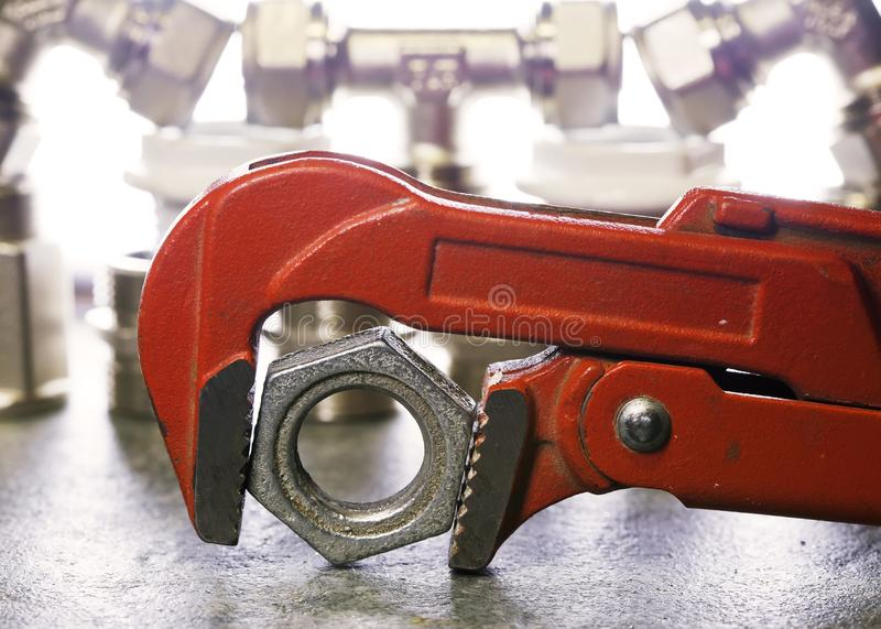 Adjust wrench power grip and elements of water and gas shutoff valves.  stock photo