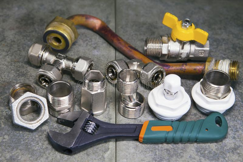 Adjust wrench power grip and elements of water and gas shutoff valves.  royalty free stock photo