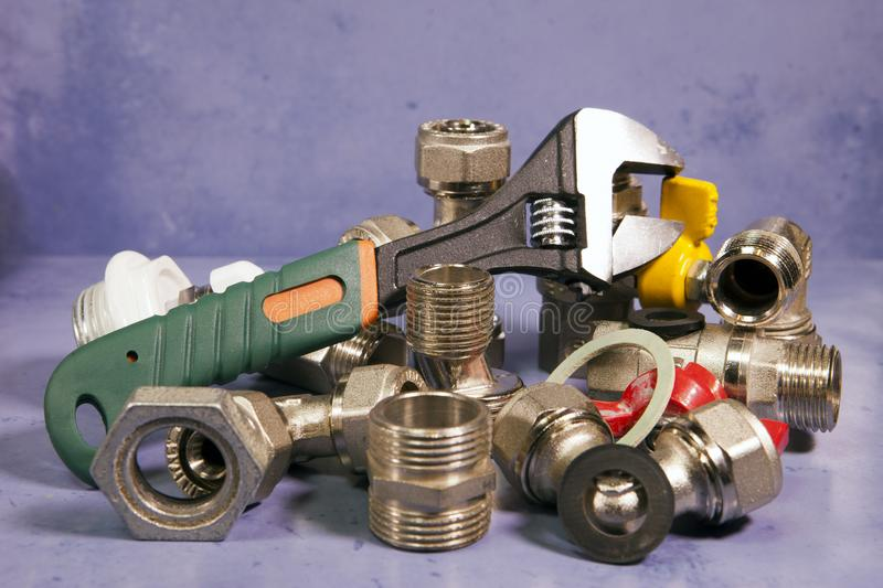 Adjust wrench power grip and elements of water and gas shutoff valves.  royalty free stock photos
