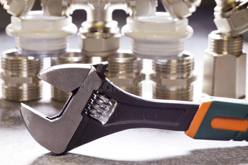 Adjust wrench power grip and elements of water and gas shutoff valves.  stock photography