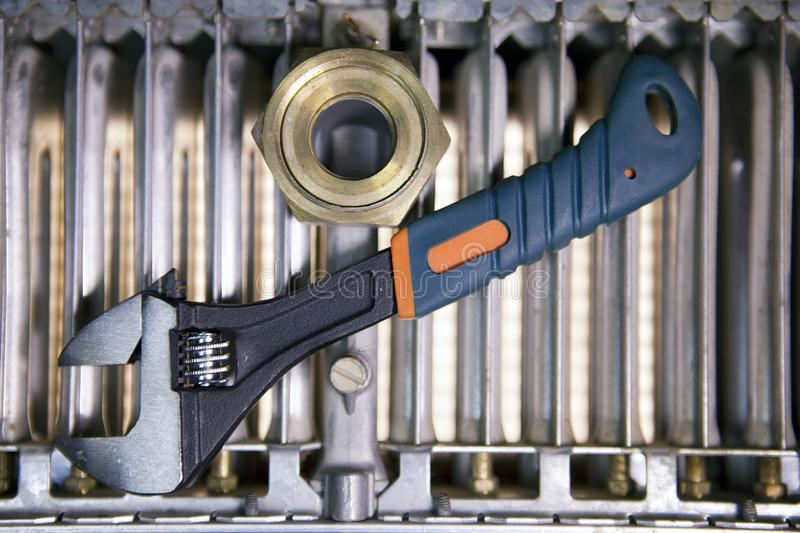 Adjust wrench power grip and elements of water and gas shutoff valves, flat la. Y royalty free stock images