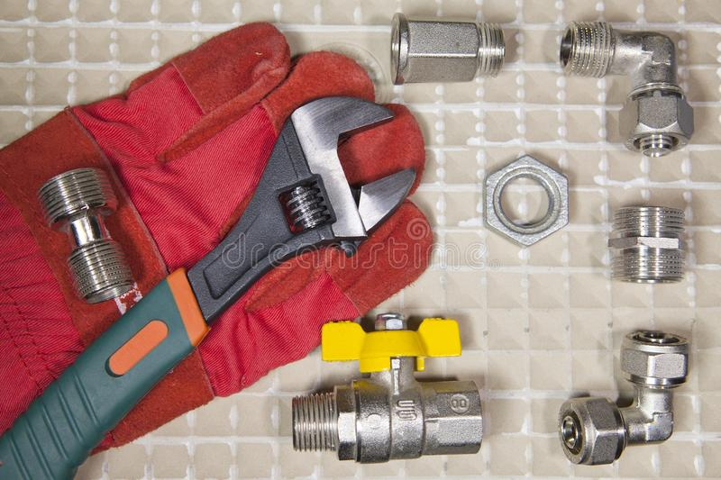 Adjust wrench power grip and elements of water and gas shutoff valves, flat lay.  stock photography