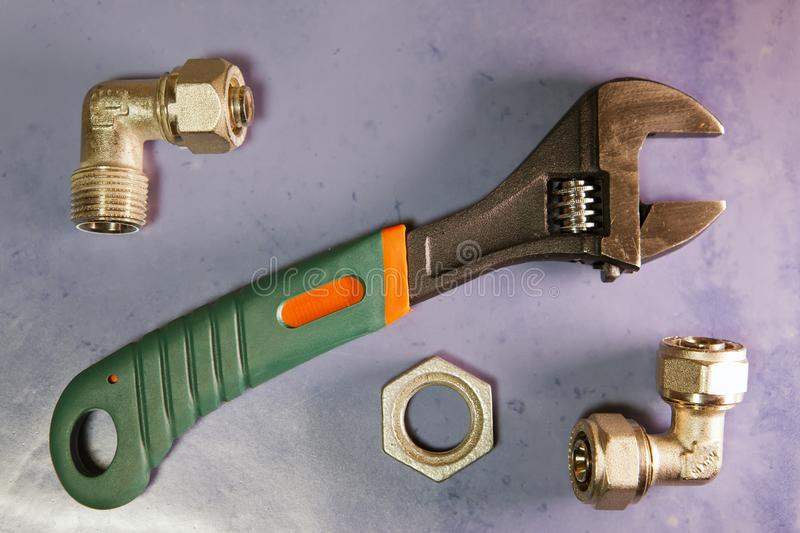 Adjust wrench power grip and elements of water and gas shutoff valves, flat lay.  stock photo
