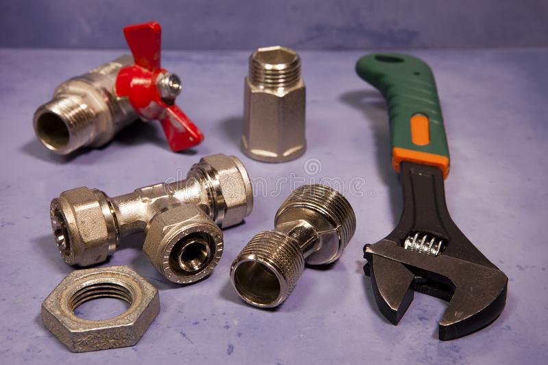 Adjust wrench power grip and elements of water and gas shutoff valves,small depth of sharpness.  royalty free stock image