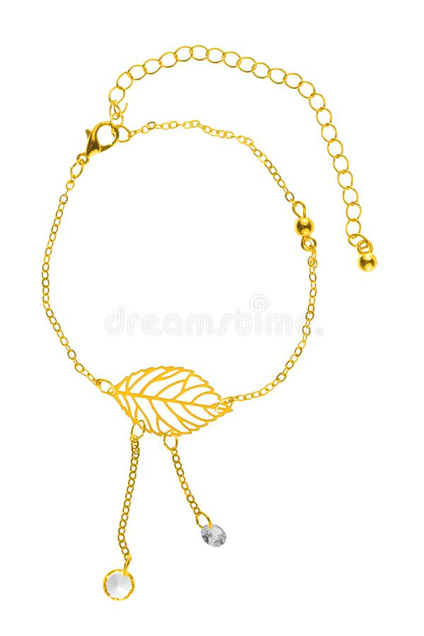 Adjustable gold bracelet with big leaf-shaped charm and two pearls on chains, isolated on white background, clipping path included royalty free stock image