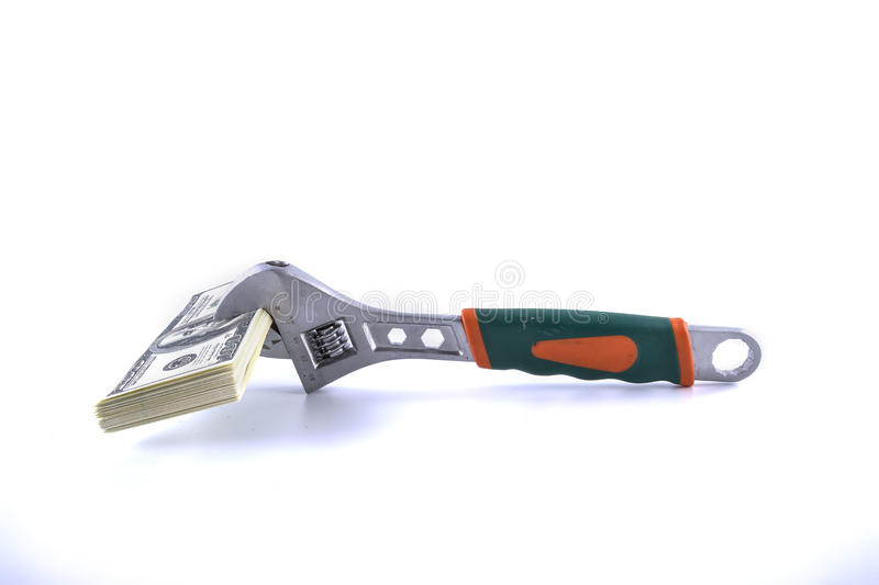 Adjustable spanner and money. Isolated iron work adjustable spanner and money stock photos