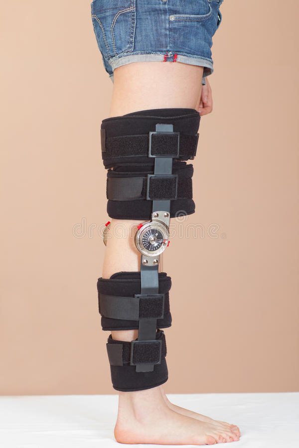 Adjustable support for leg or knee injury. Adjustable angle support for leg or knee injury, side view, straight leg royalty free stock images